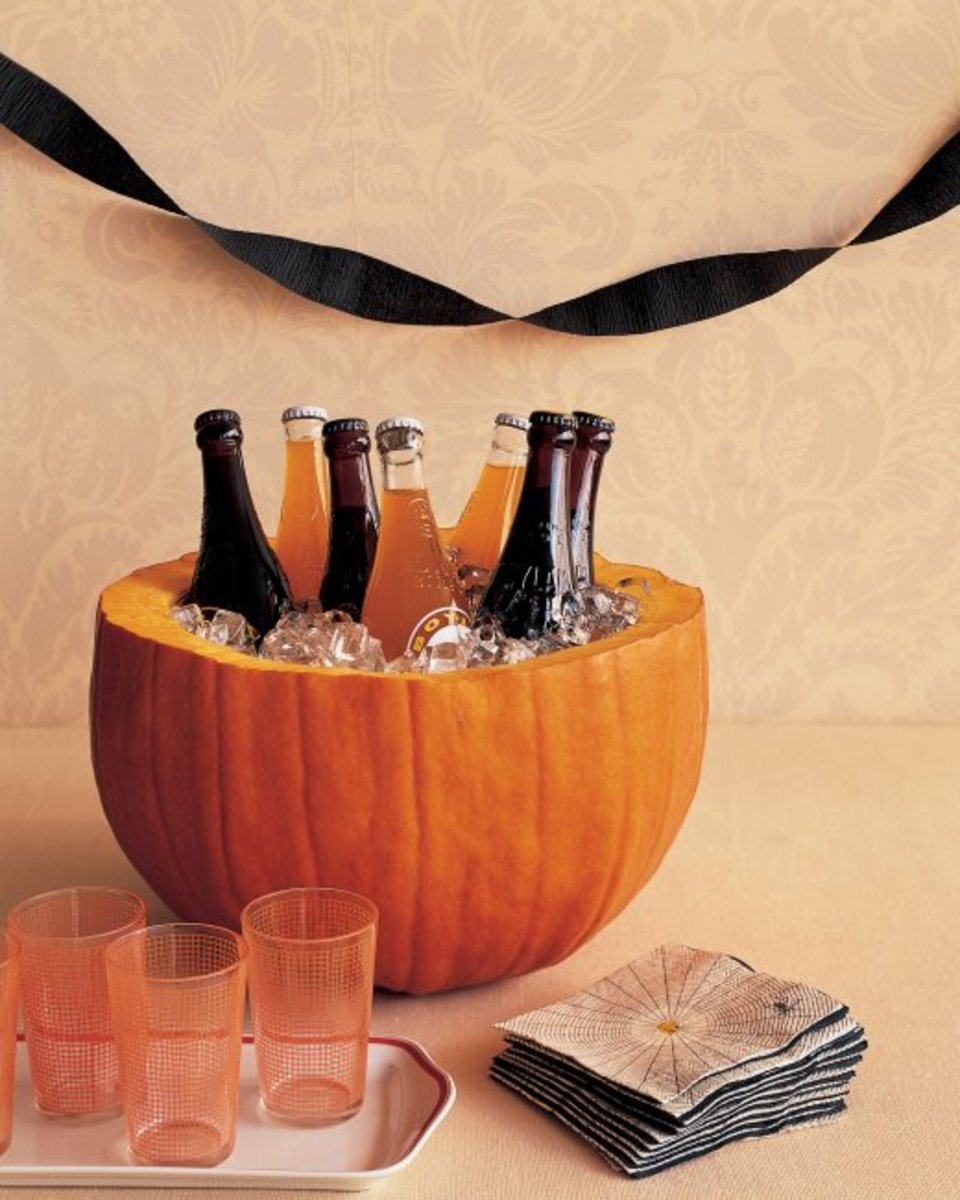 An innovative way to keep beer cold is to chill it in a pumpkin.