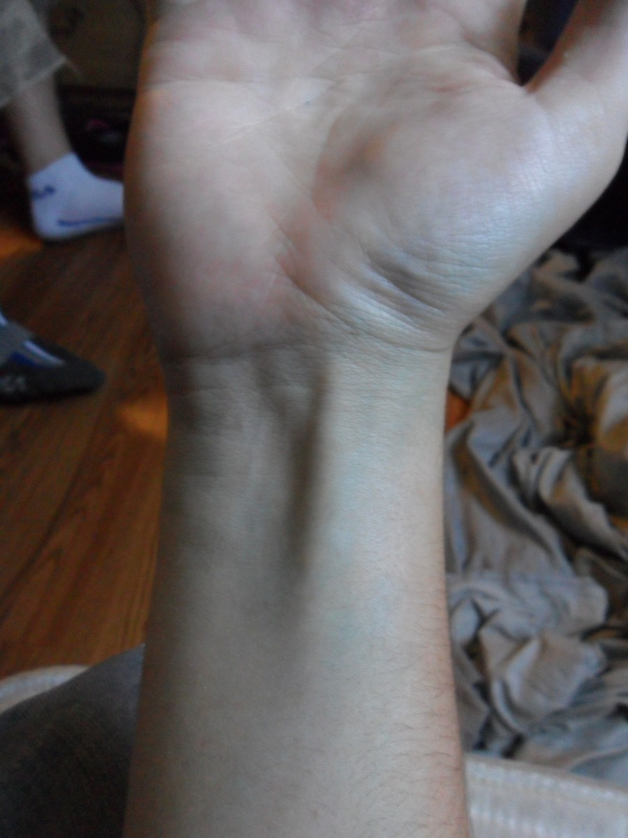 You can see the area around my wrist is now a nice sickly blue.  I also got a little creative and started going up my palm.
