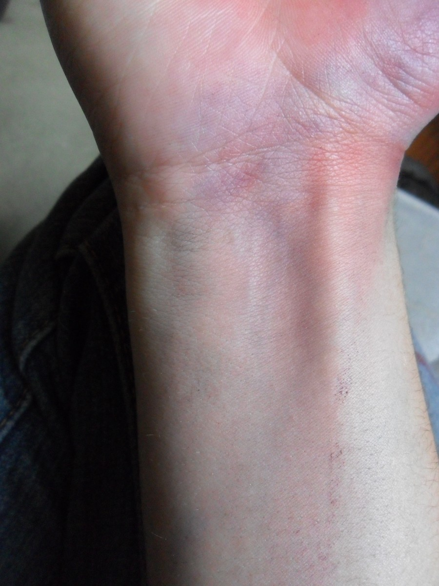 After adding blending some red into my base layer, my wrist now shows a spotty mix of purple, red, and blue.