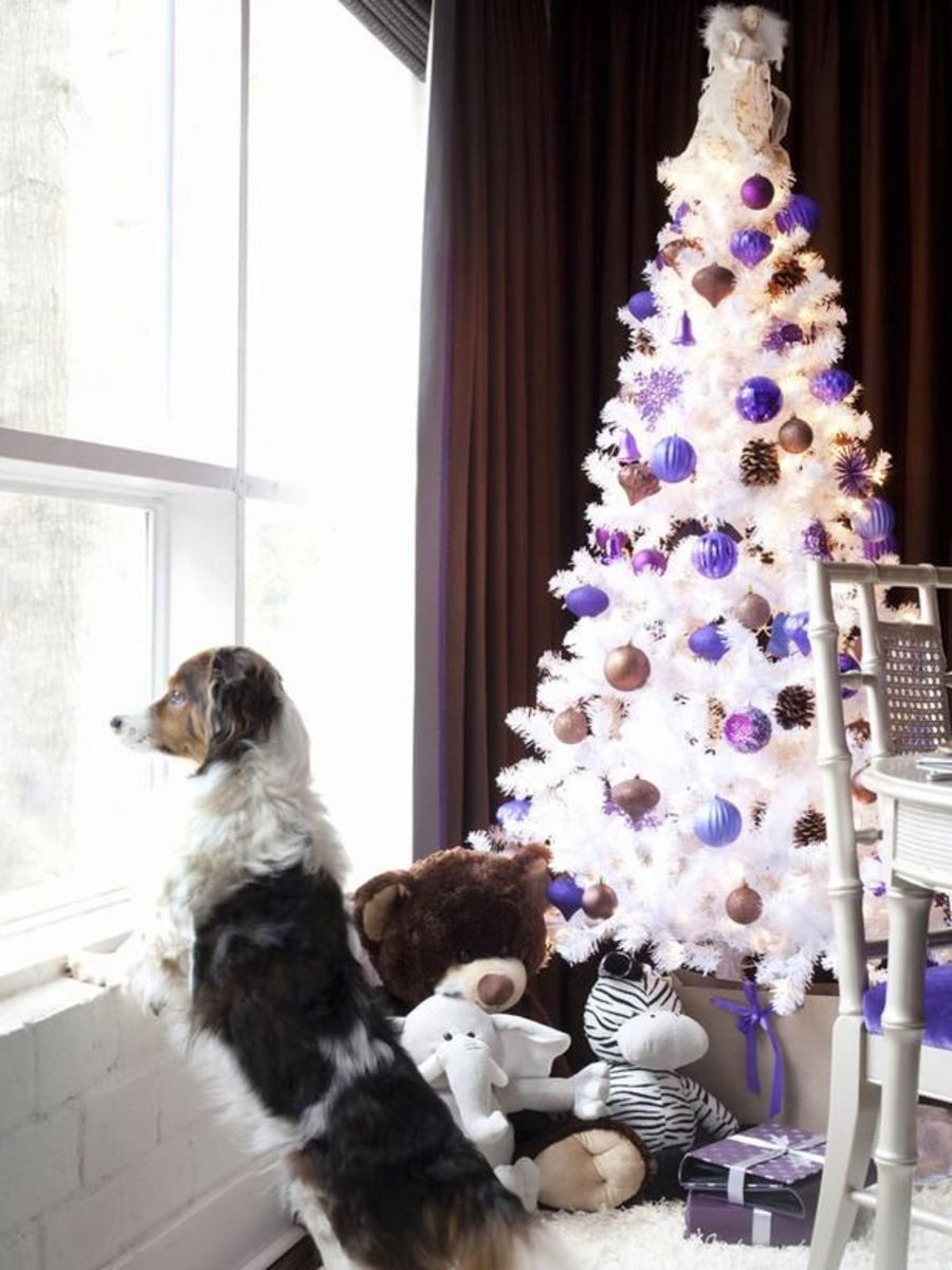 White Christmas tree decorated in purple