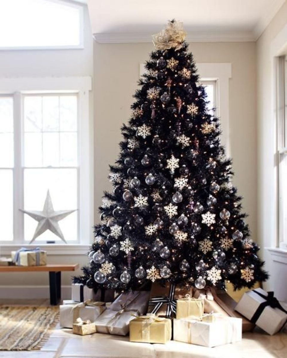 Black Christmas tree with white snowflakes and clear ornaments.