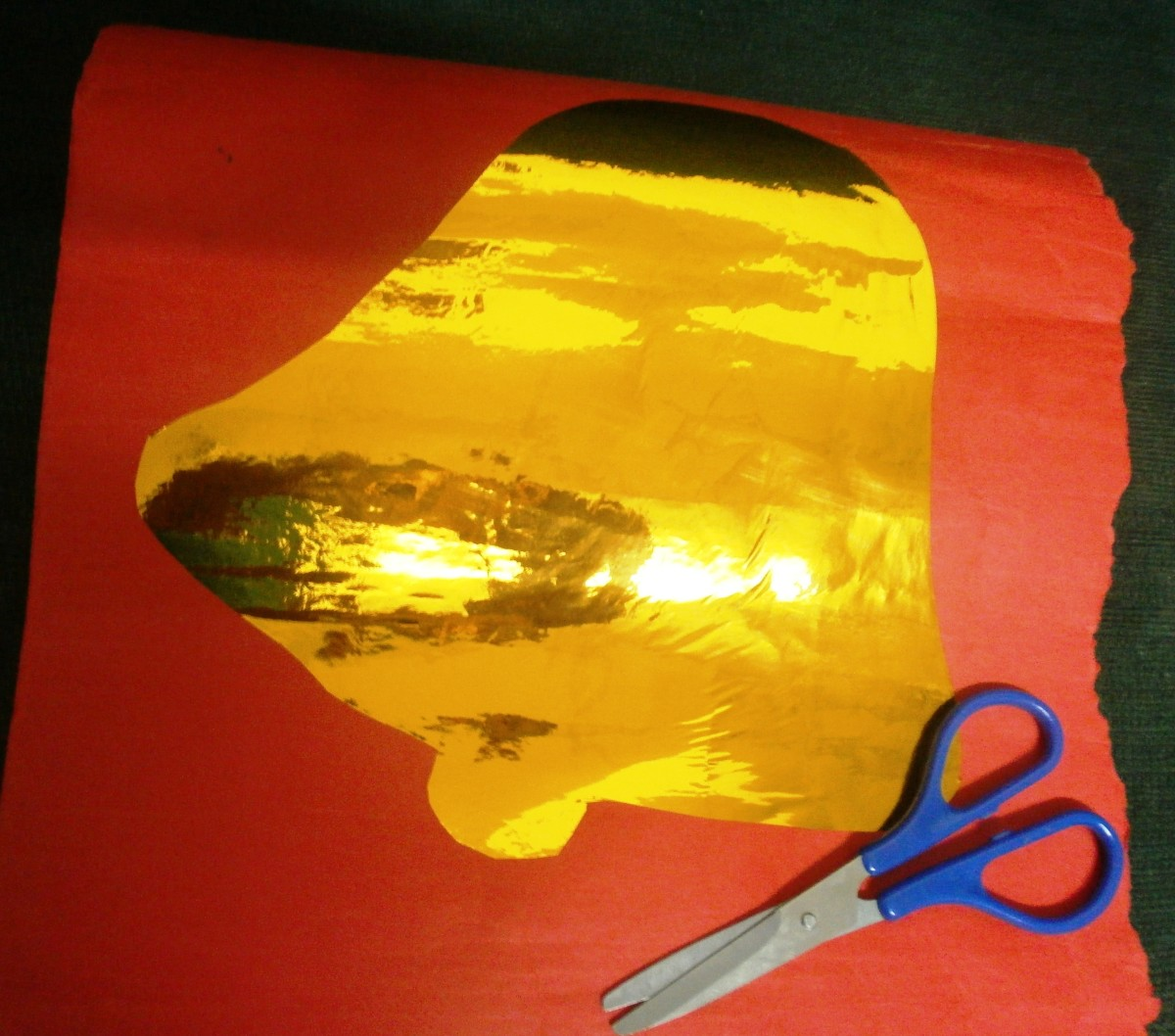 Bell yellow foil on cardboard to be cut out.
