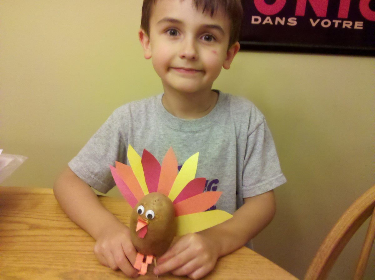My son showing off his potato turkey.