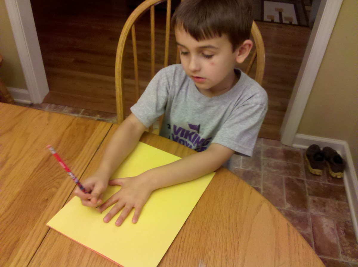 Trace your child's hand on yellow, red, and orange construction paper.