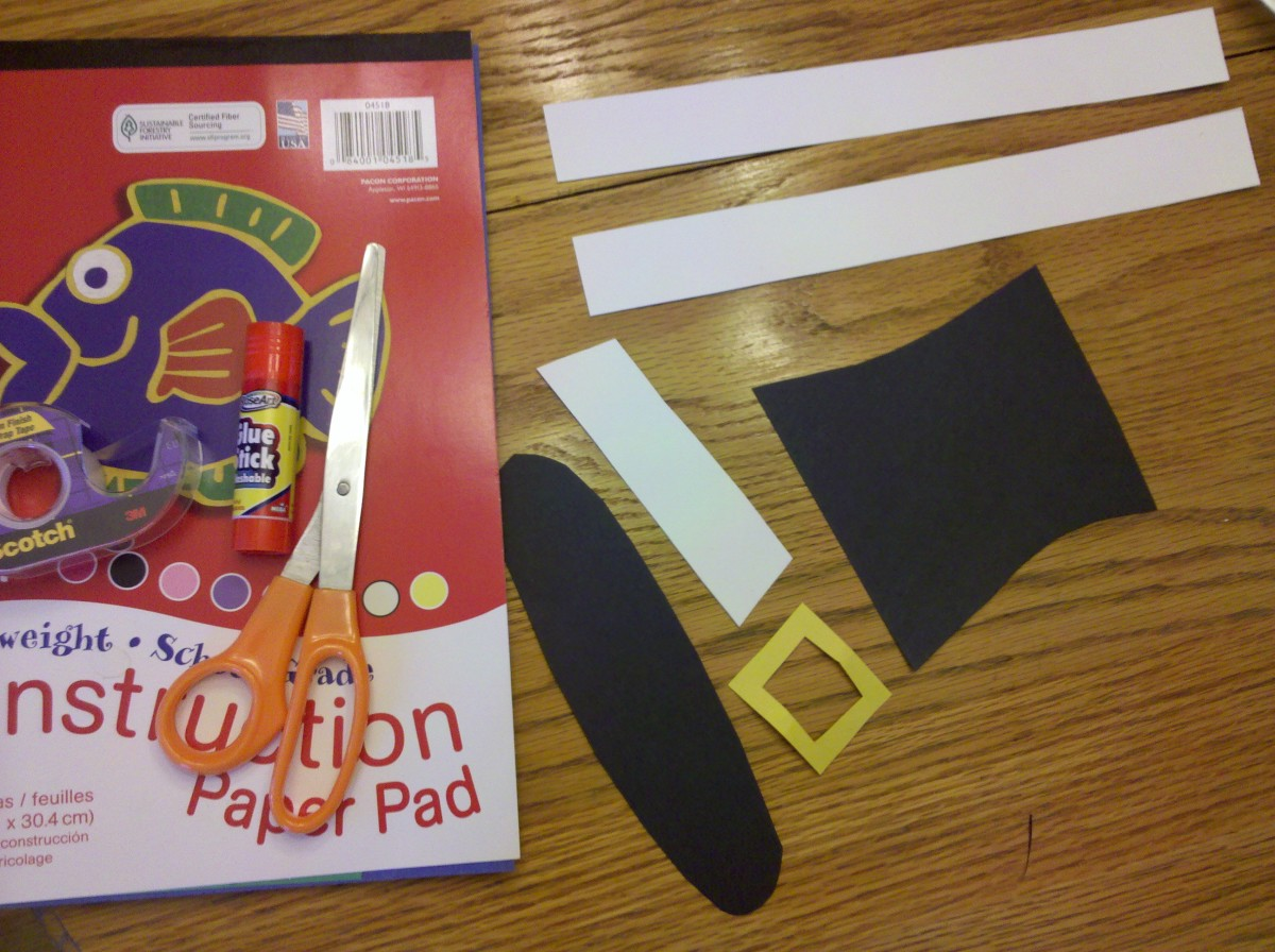 Cut out hat shape, white strip, and buckle from construction paper.