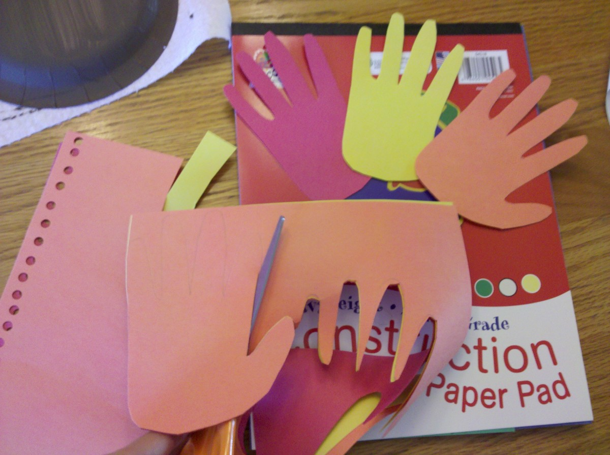 Trace and cut your child's hand out of red, yellow, and orange construction paper.