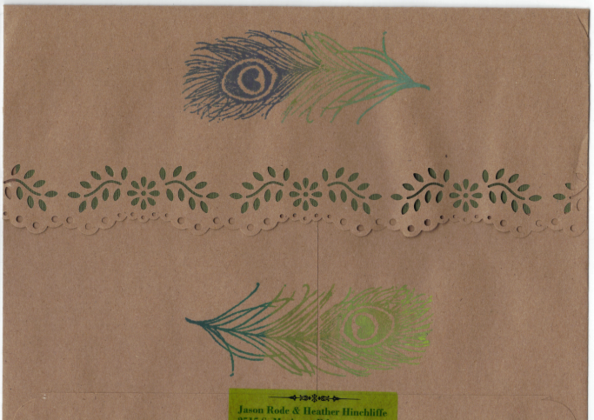 Hand-stamped colorful feathers on our handmade envelopes.