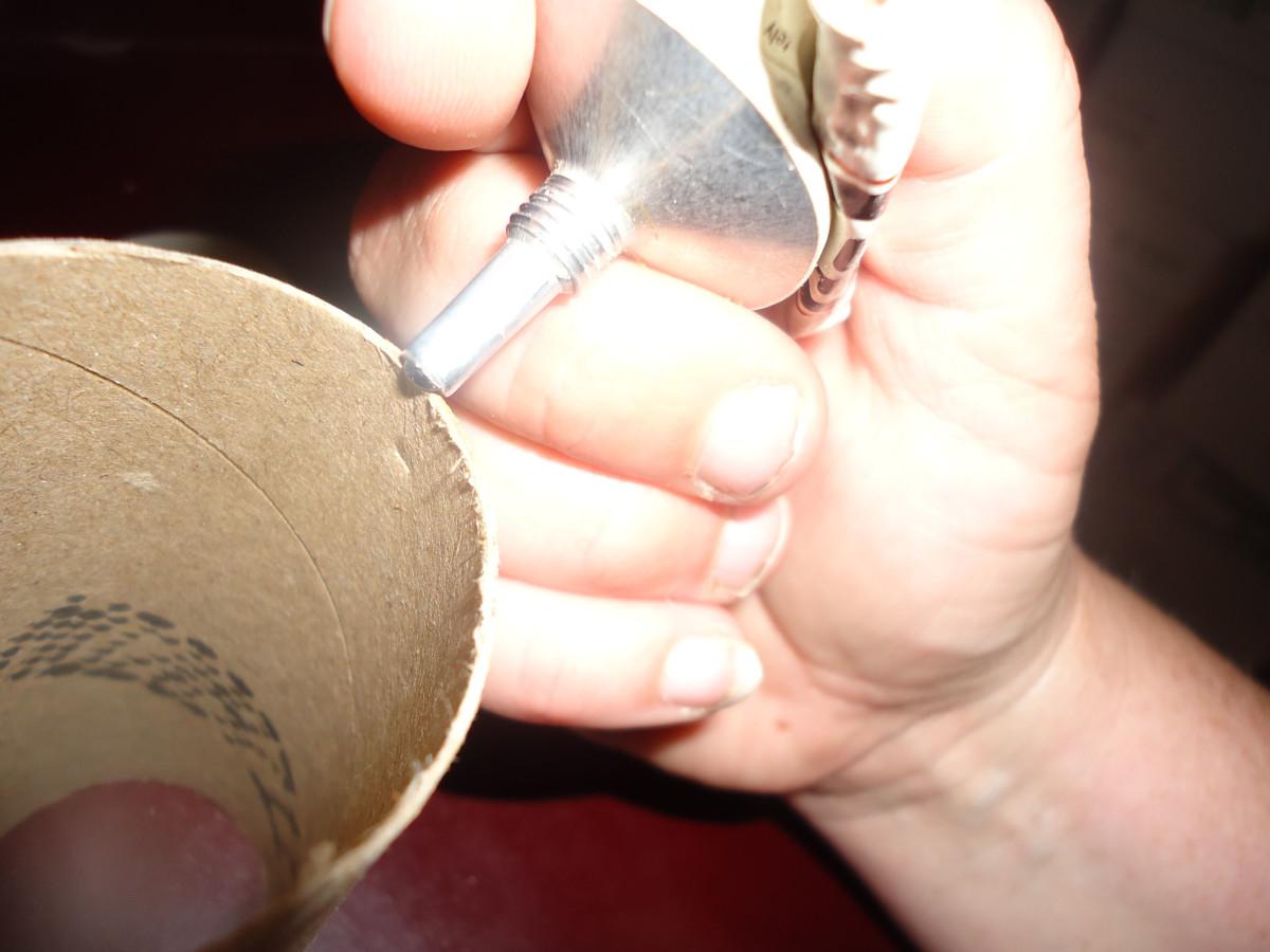 Put glue around edge of tube and glue circle on