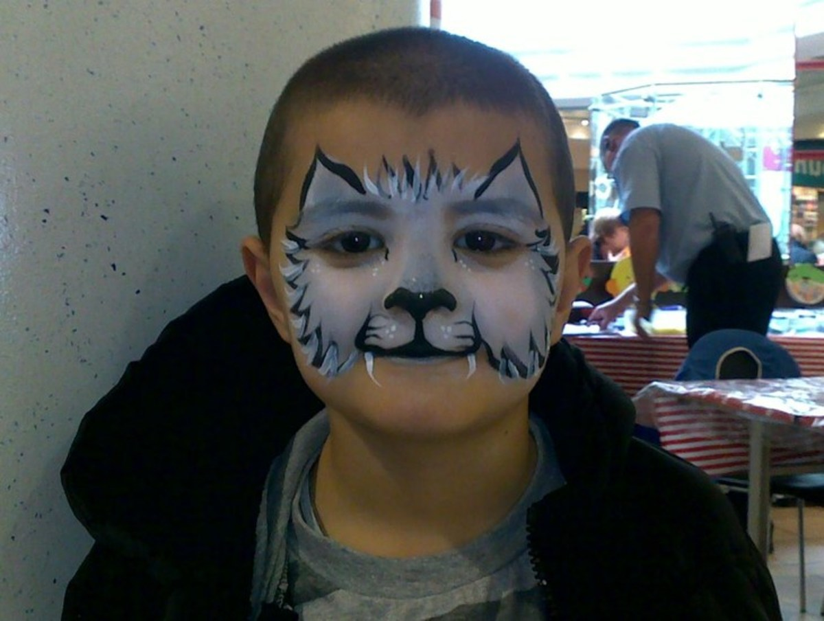 Here's a full cat head painted on a little boy.