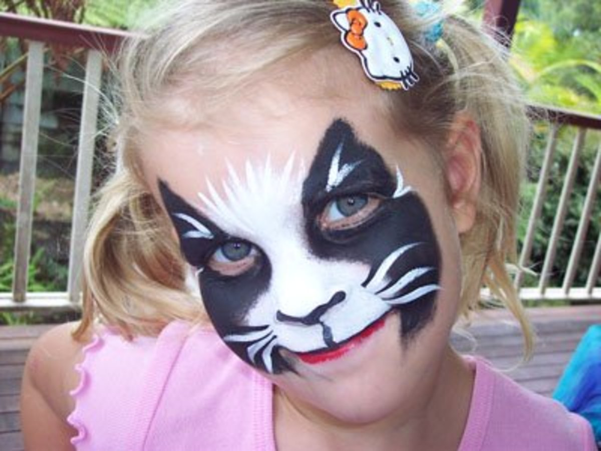 You can paint your child's face in the design of particular cat breeds or colorations, such as the tuxedo cat.