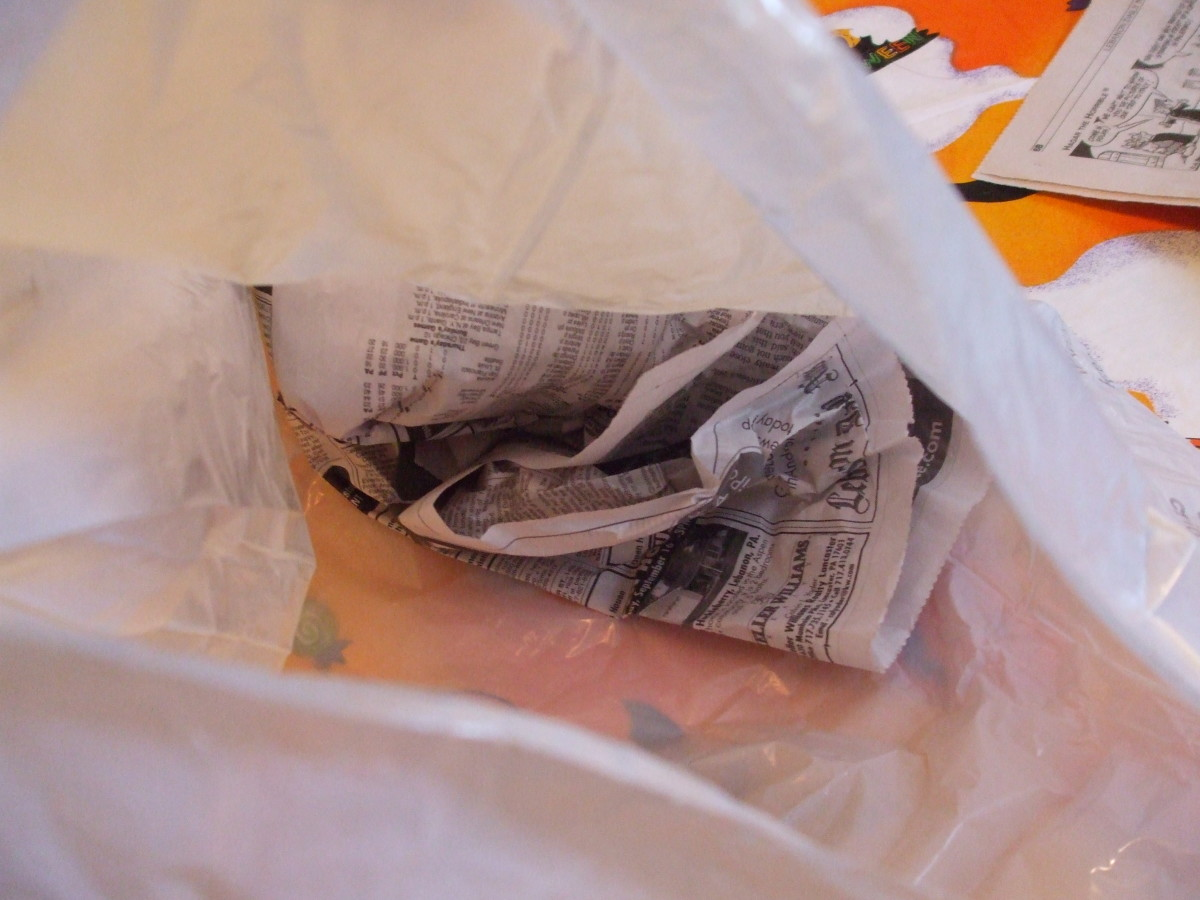 This ghost decoration is being filled with old newspaper.