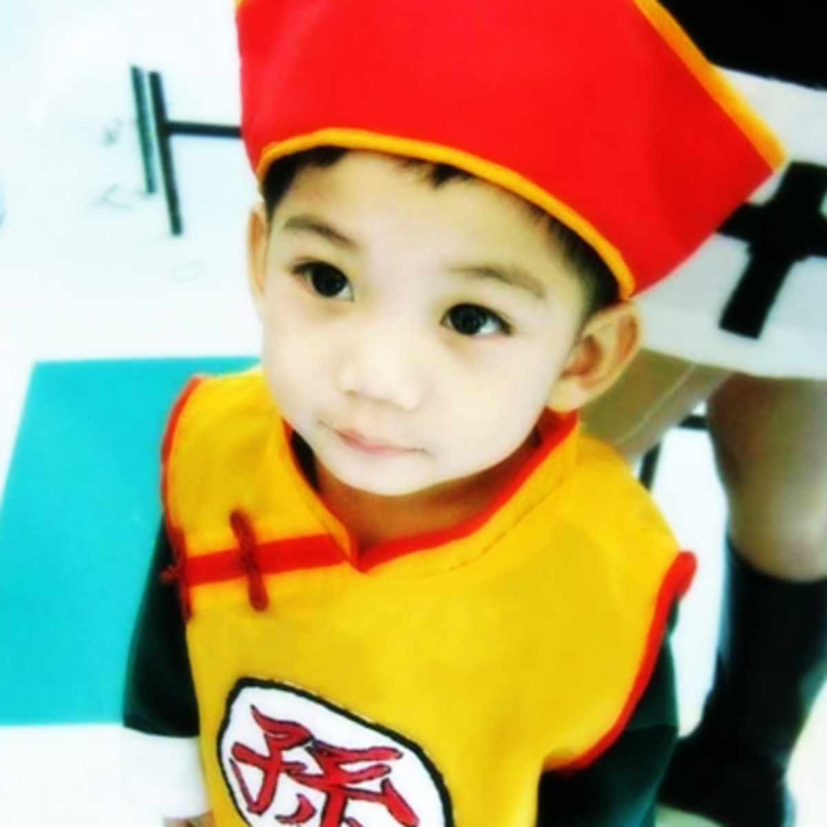 Dressing as Son Gohan involves a hat, which saves you the effort of styling your kid's hair.