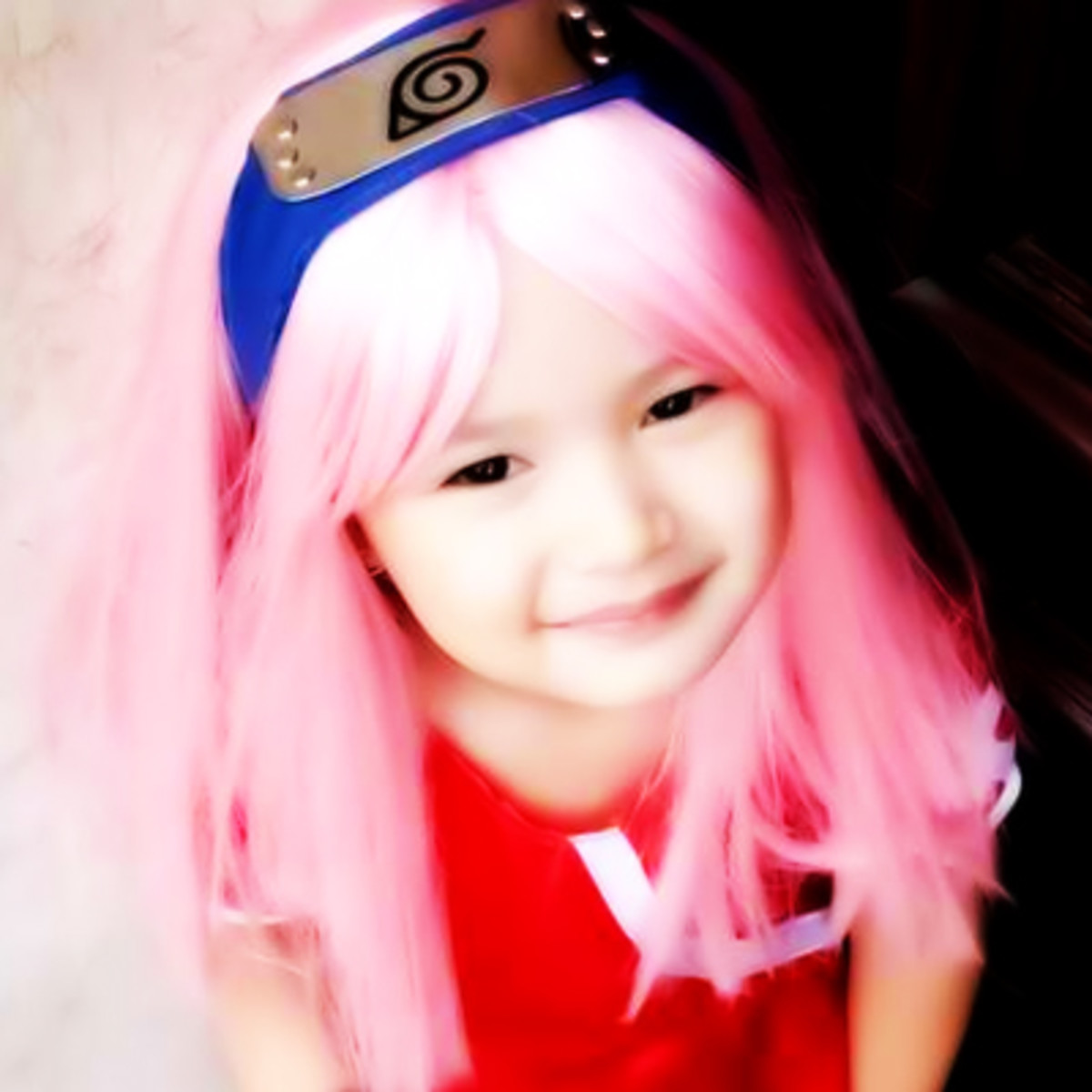 A long pink wig is the focal point of a Sakura Haruno costume.