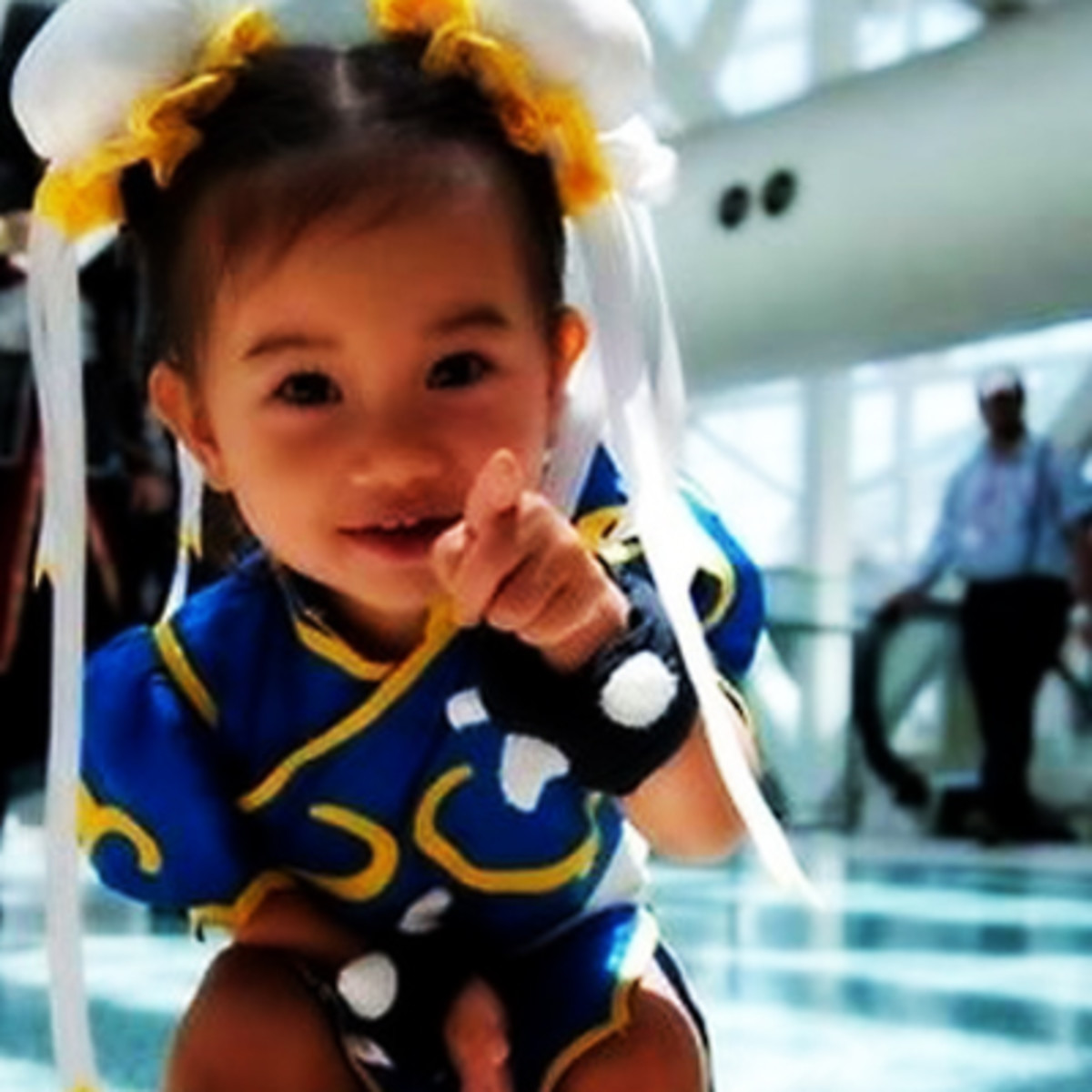 A homemade Chun Li costume is a little tricky, but store-bought costumes are also available. The hairstyle is a key feature of this costume.