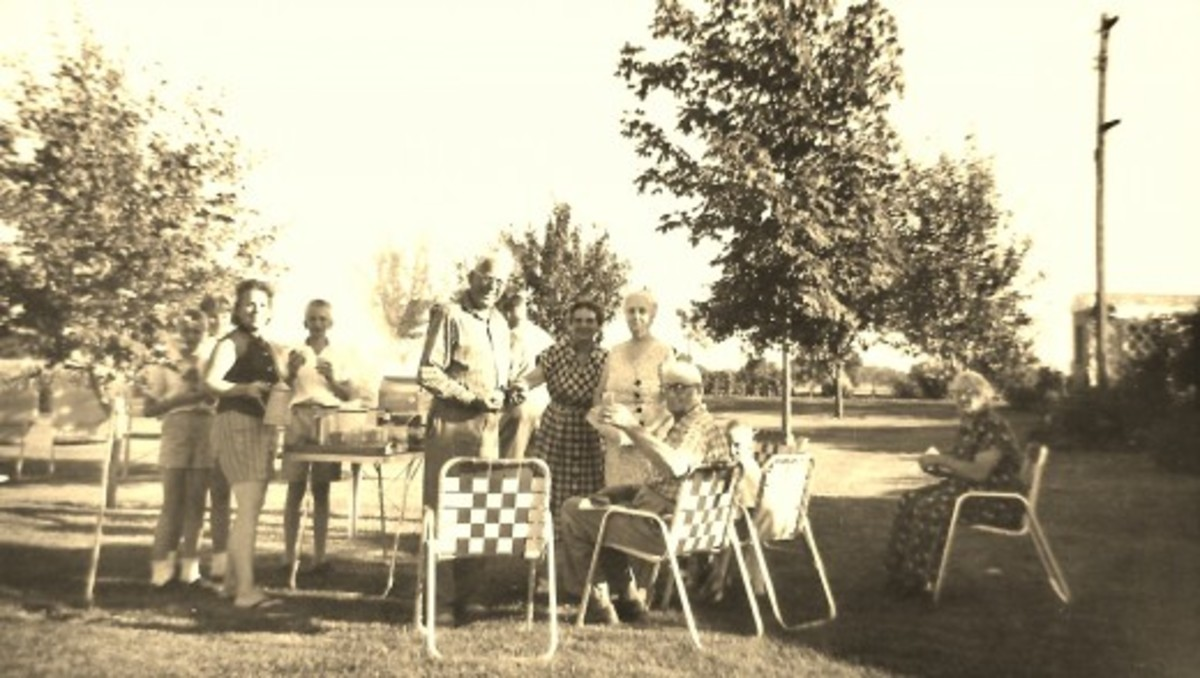 Old family photo of some of our relatives getting ready to enjoy a picnic outdoors.