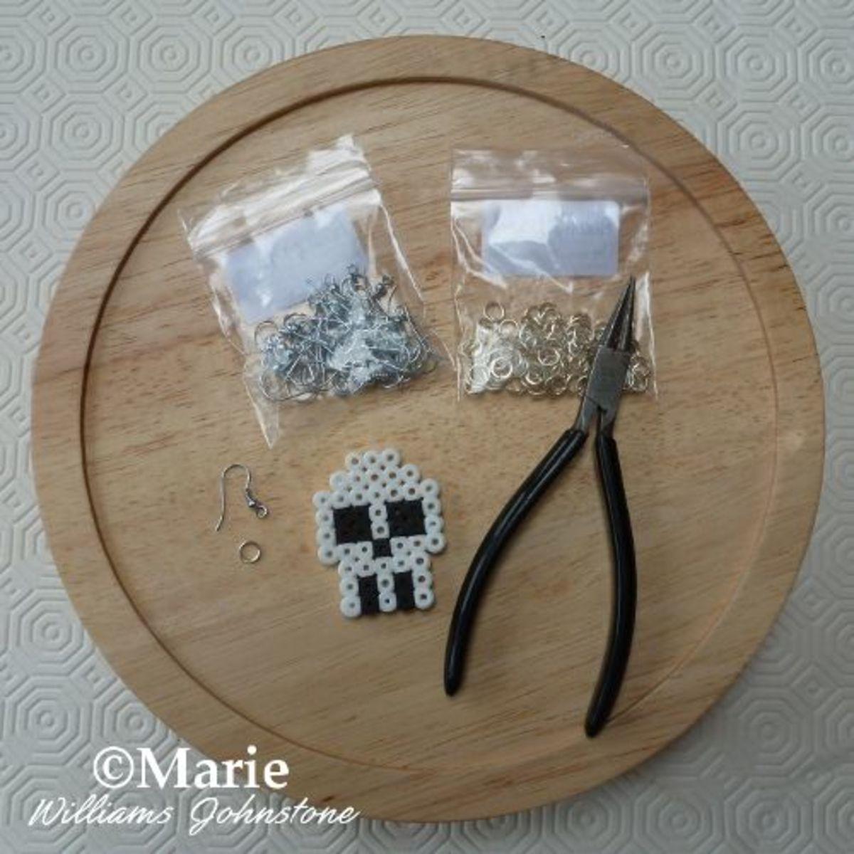 Turn finished Perler and Hama bead designs into wearable jewelry using basic tools.
