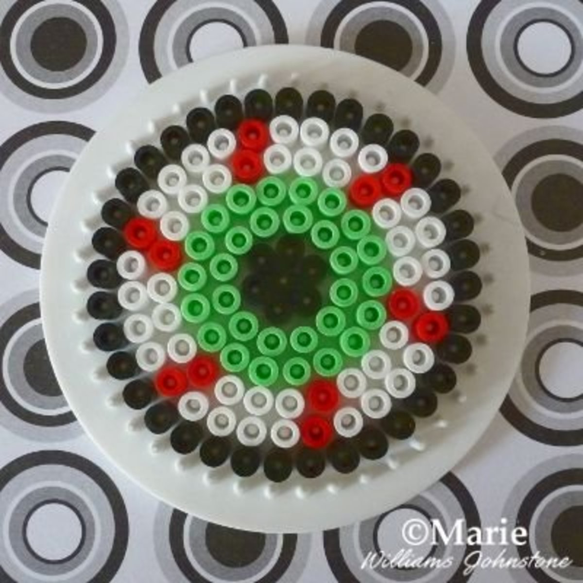 This bloodshot eye design is perfect for making Halloween coasters.