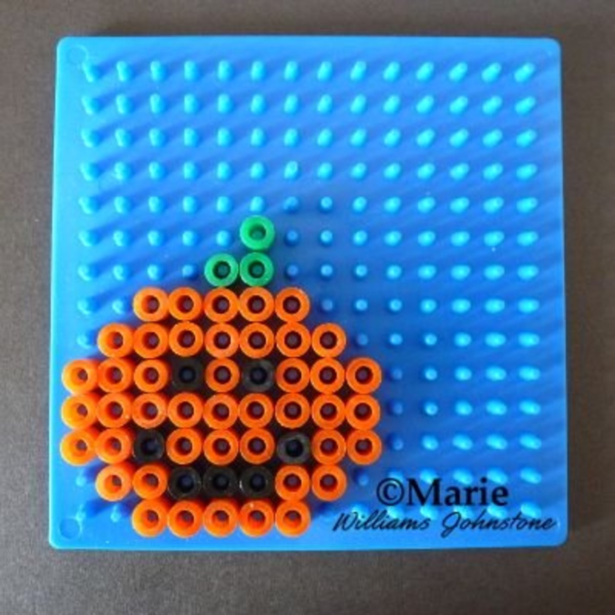 This smiling jack-o-lantern design can also be made as a plain pumpkin if you omit the black beads.