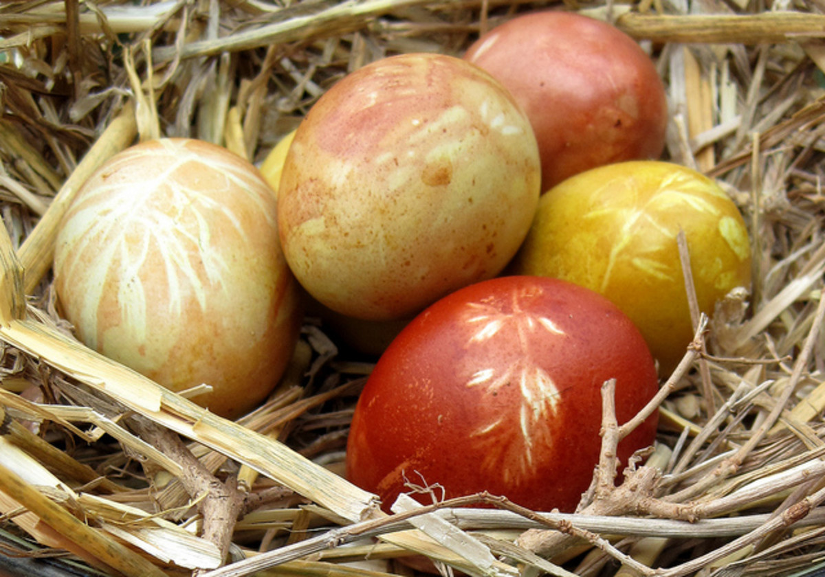 Naturally dyed Easter eggs with leaf patterns.
