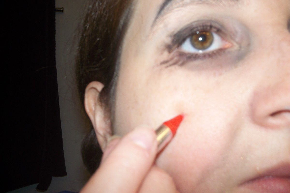 Use the red makeup for rosy cheeks.  Apply as a circle and then smudge it.