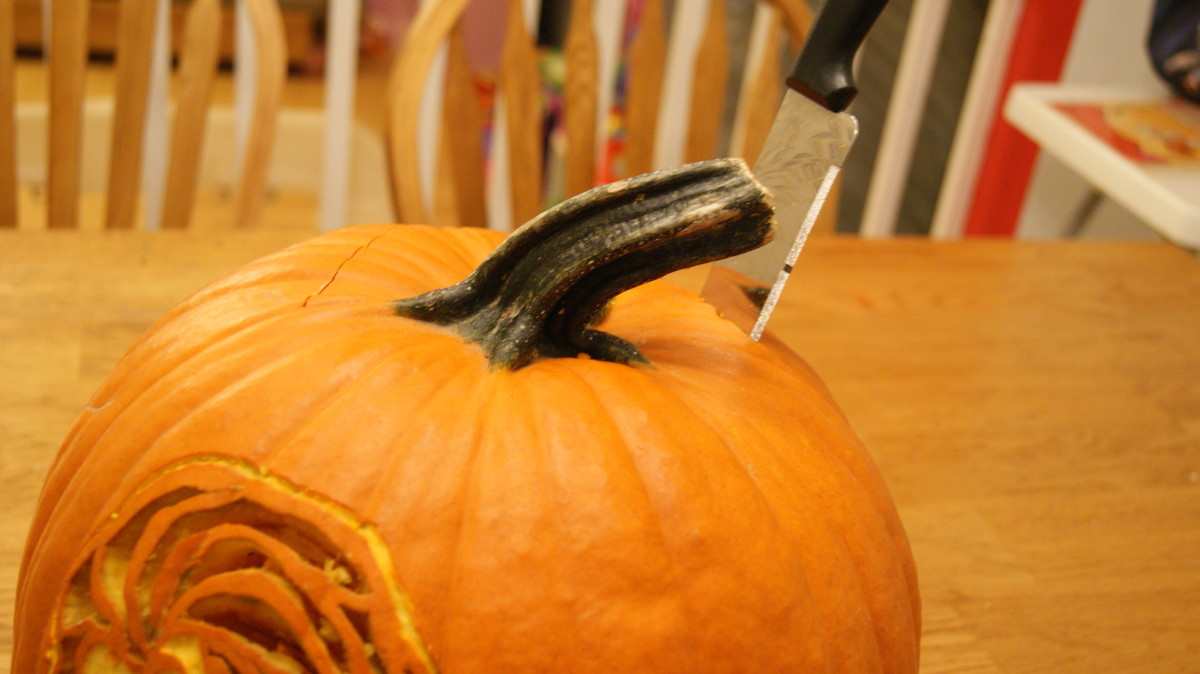 When cutting the lid of a pumpkin go in at an angle to the pumpkin and make the cuts an odd shape