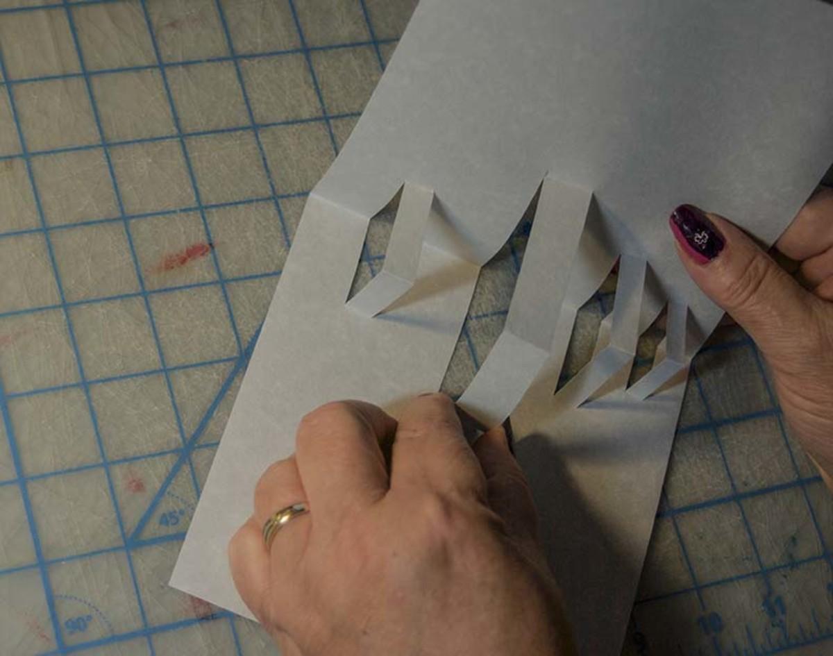 Fold the slots inward.