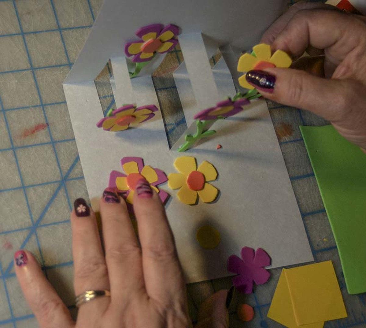 Glue stems and flowers onto slots.