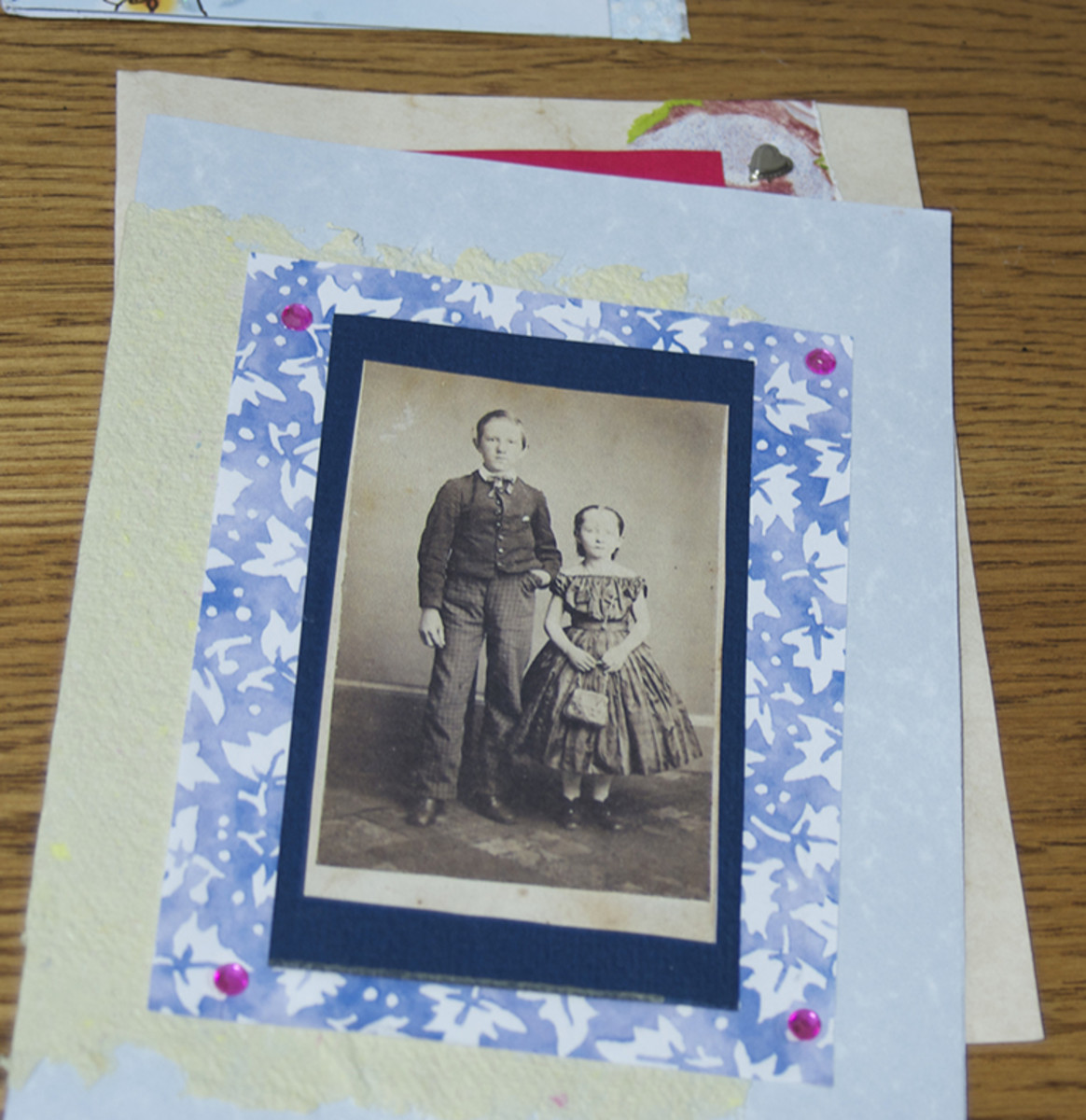 Use old photos (copies) and jewels with colored paper.