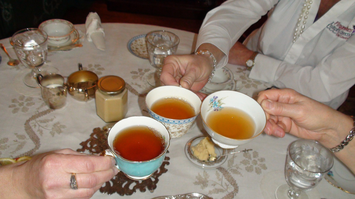 Tea is a must for any Victorian 1800s-themed tea party . . . even if you have to spike it!