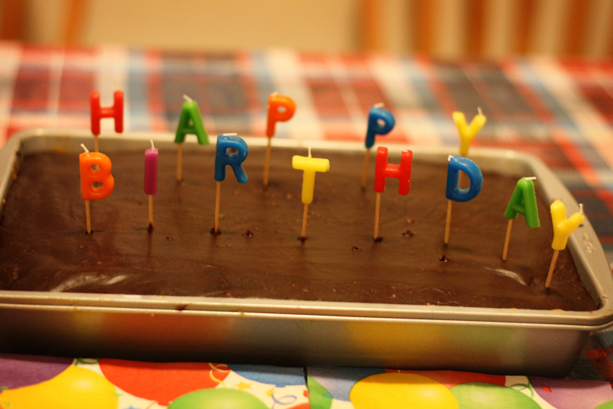 This simple chocolate-frosted cake uses fun candles for decoration.