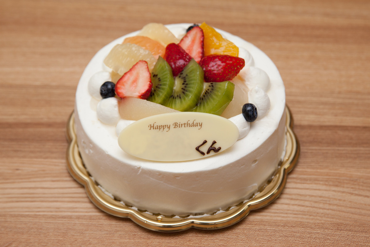An elegant cake topped with fruit.