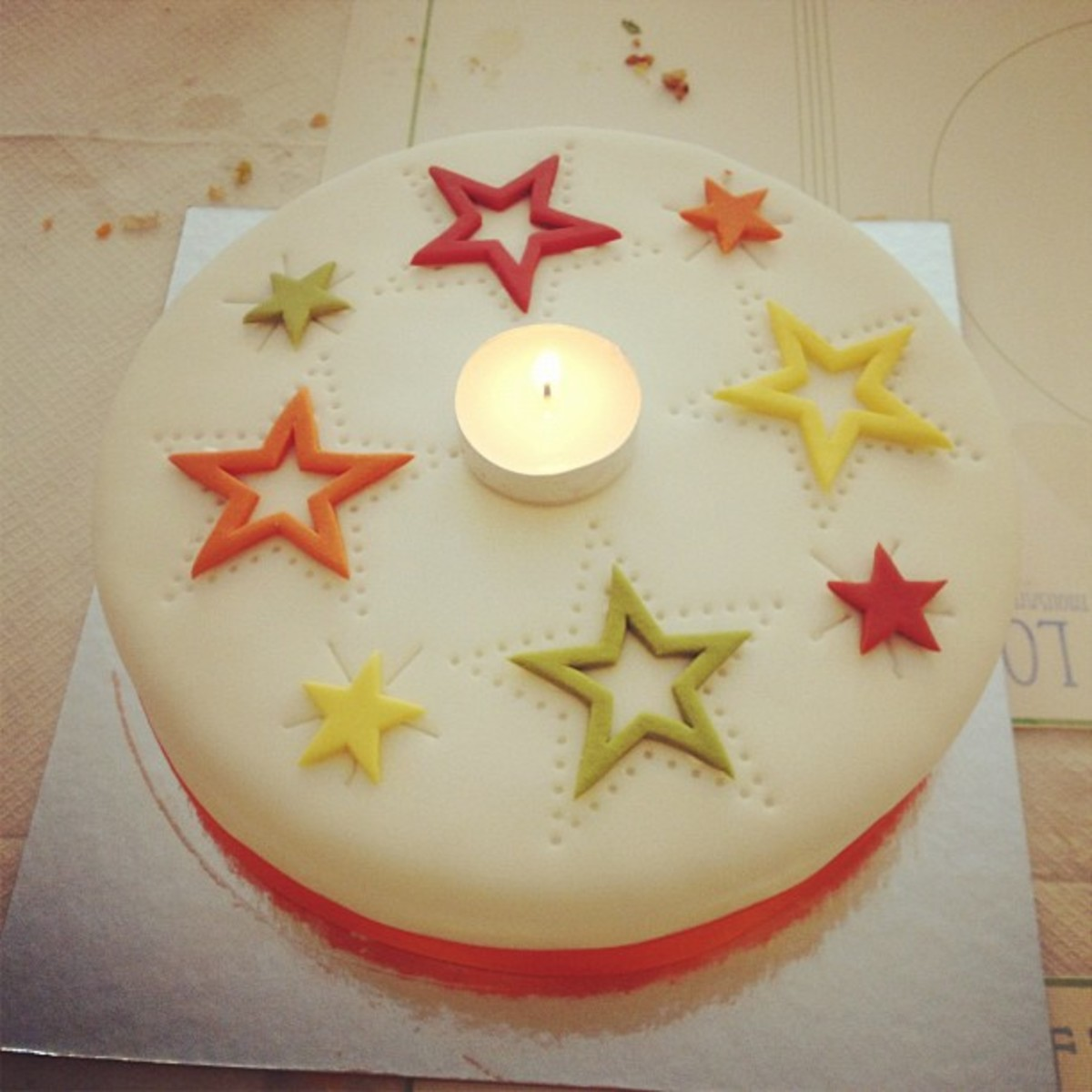 A birthday cake decorated with stars.