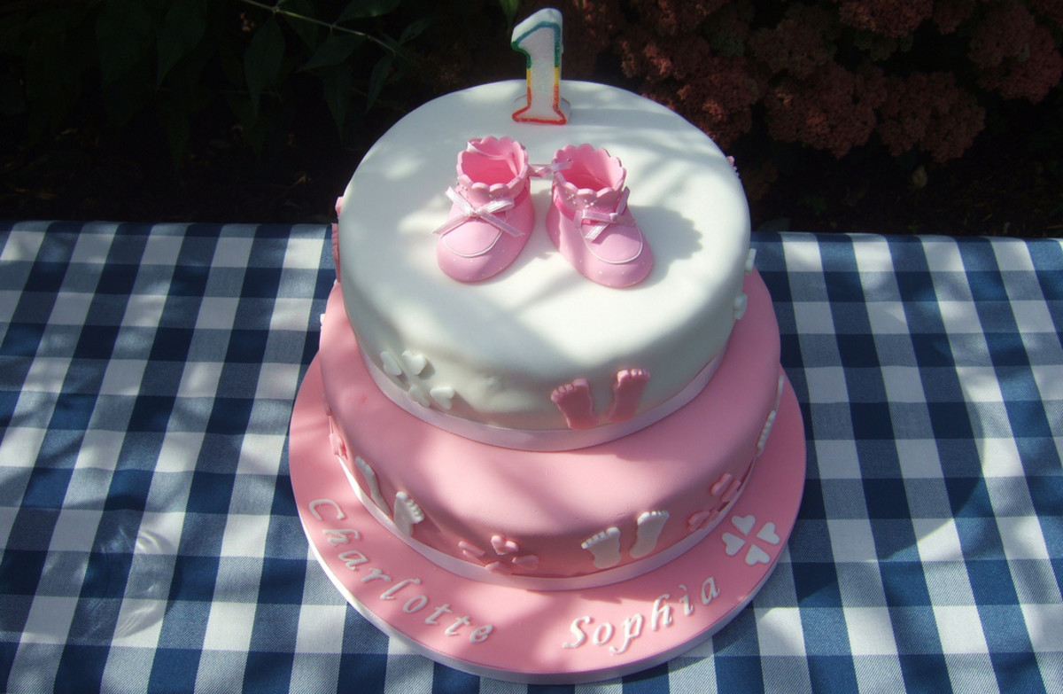 pink and white birthday cake for a 1 year old