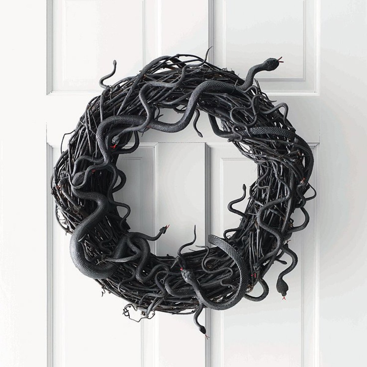 This was the first Halloween wreath that I made.  I had bought a bunch of things to decorate for Halloween, among them a bag of snakes.