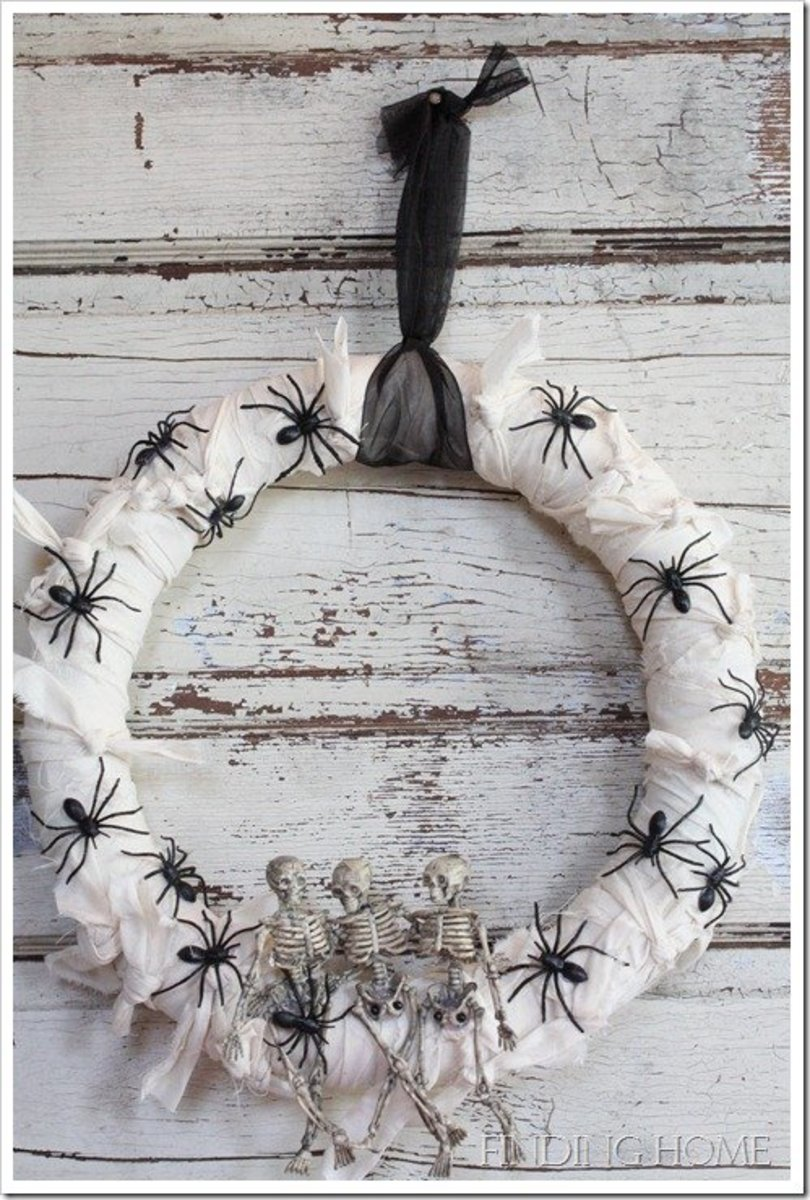 This mummified wreath was done using a muslin type fabric that was torn by hand to get the rough edges. Again, special effects were added using plastic spiders and skeletons.