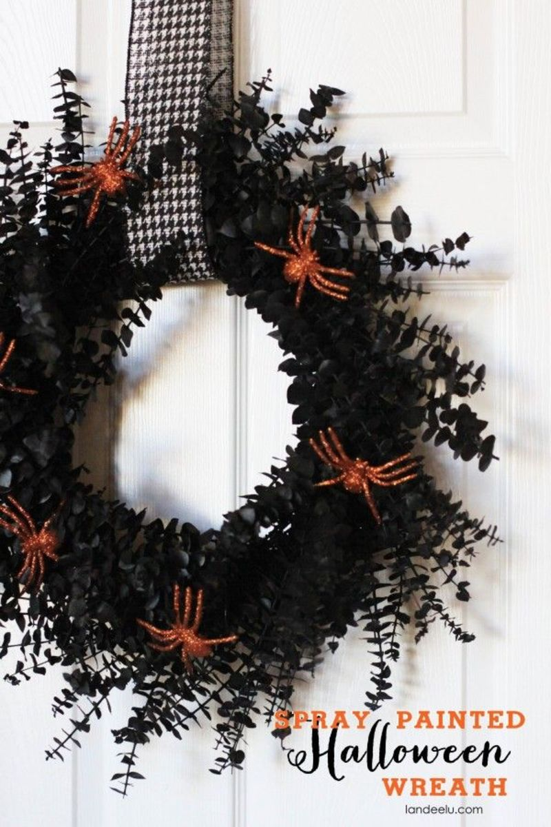 This one is easy enough.  Make a wreath using eucalyptus. Spray paint using black.  Add some creepy-crawlies.