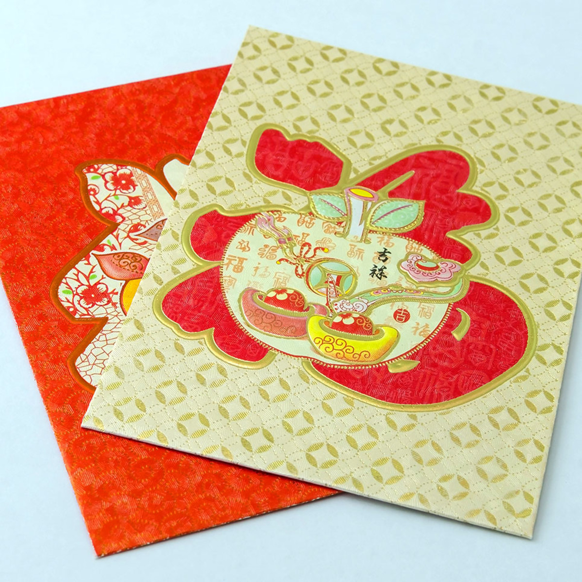 Chinese New Year red packets. Nowadays, they come in many shades of red, pink, and gold.