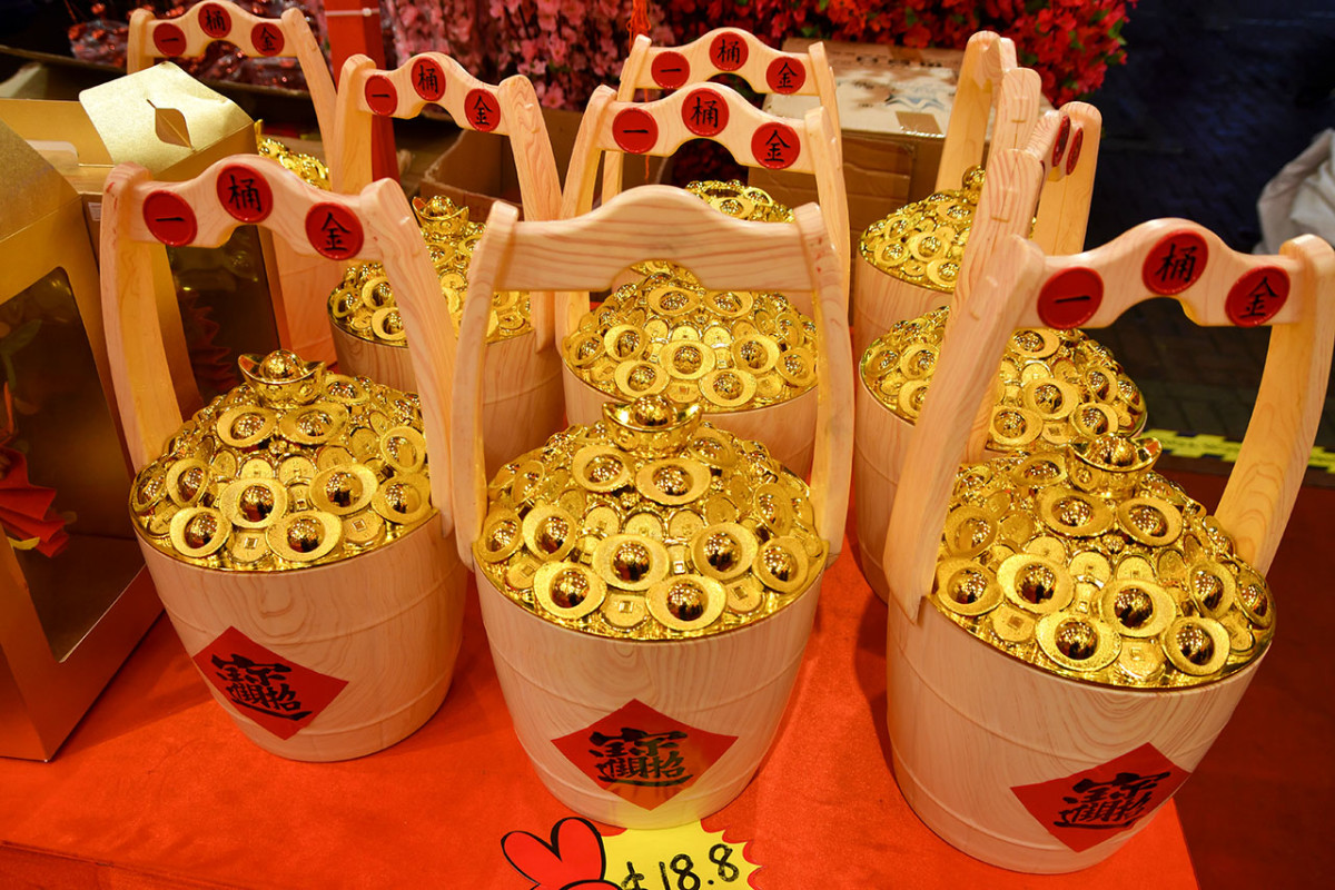 """Gaudy and affordable, faux """"buckets of gold"""" are great Chinese New Year business gifts."""