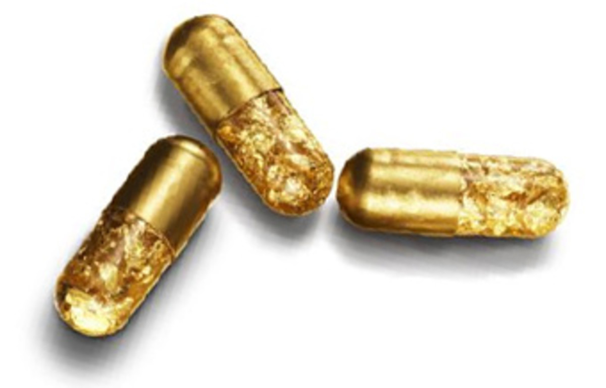 Gold-dipped pills, filled with 24-karat gold leafing