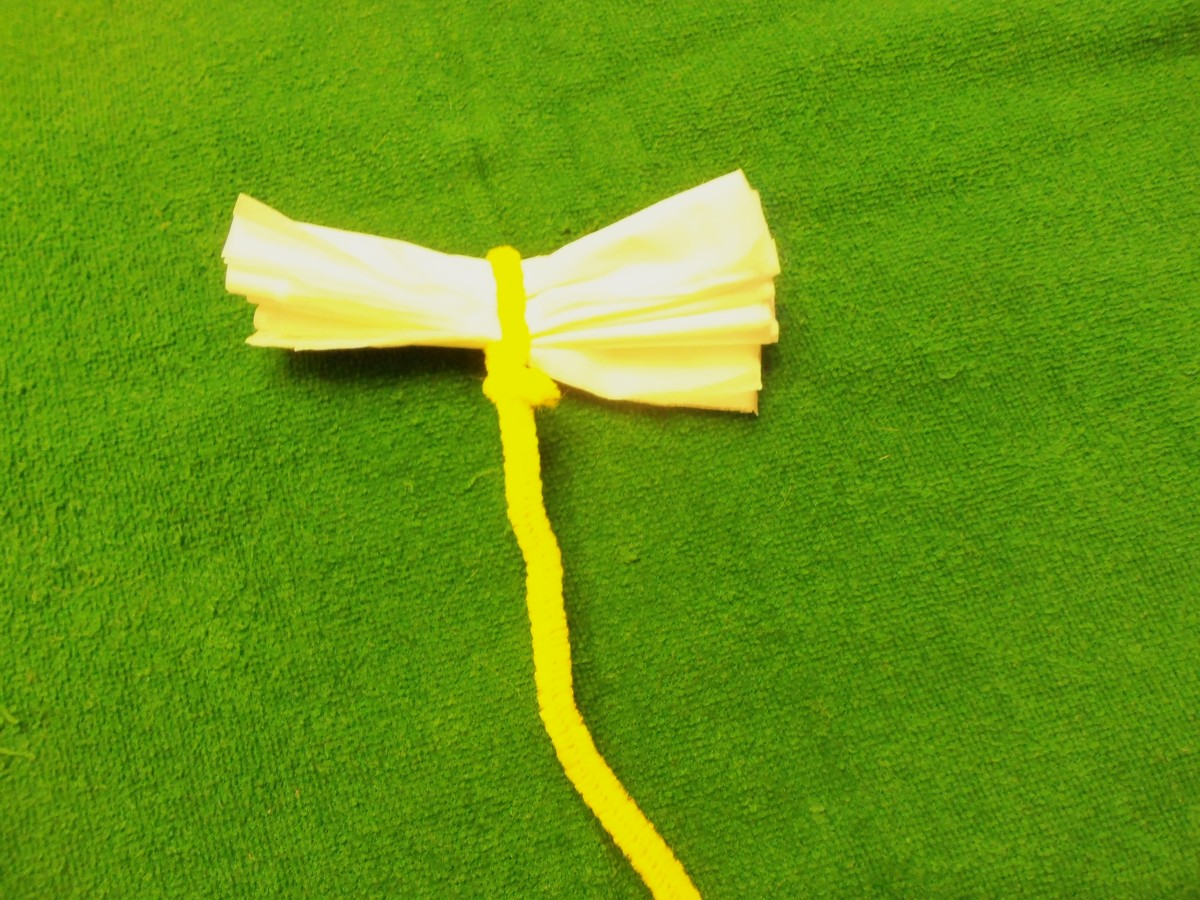 # 8 Tissue Paper Flowers-Using a facial tissue, showing the fold and the pipe cleaner stem.