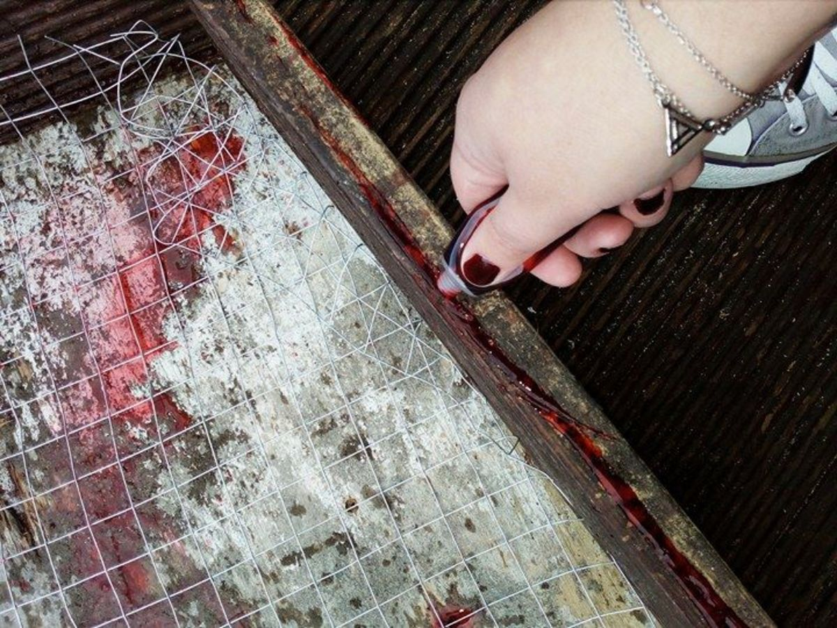 Fake blood adds an additional element of fright to handmade Halloween decorations.