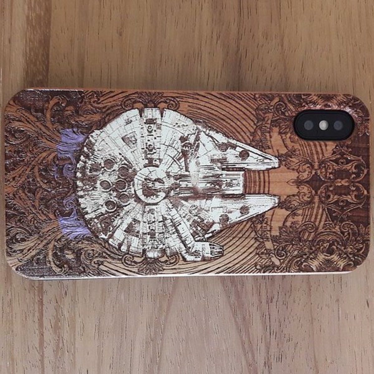 The Engravers Dungeon on Etsy does beautiful work. They have tons of different wood phone covers and they make posters from woodcuts, too.