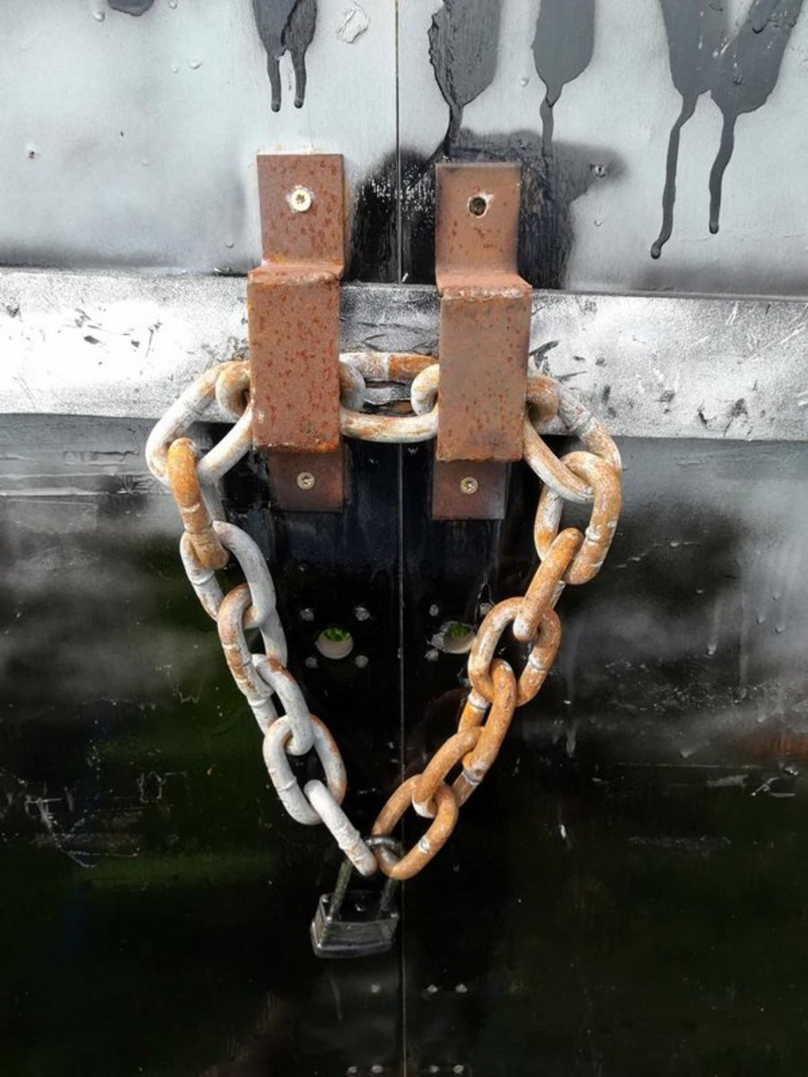 Securing the door from the Zombies with a lock and chain