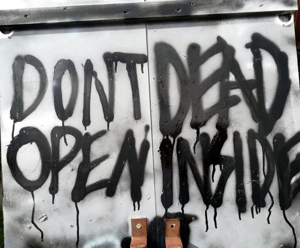 """DONT OPEN DEAD INSIDE"" is written on the zombie door in the show."