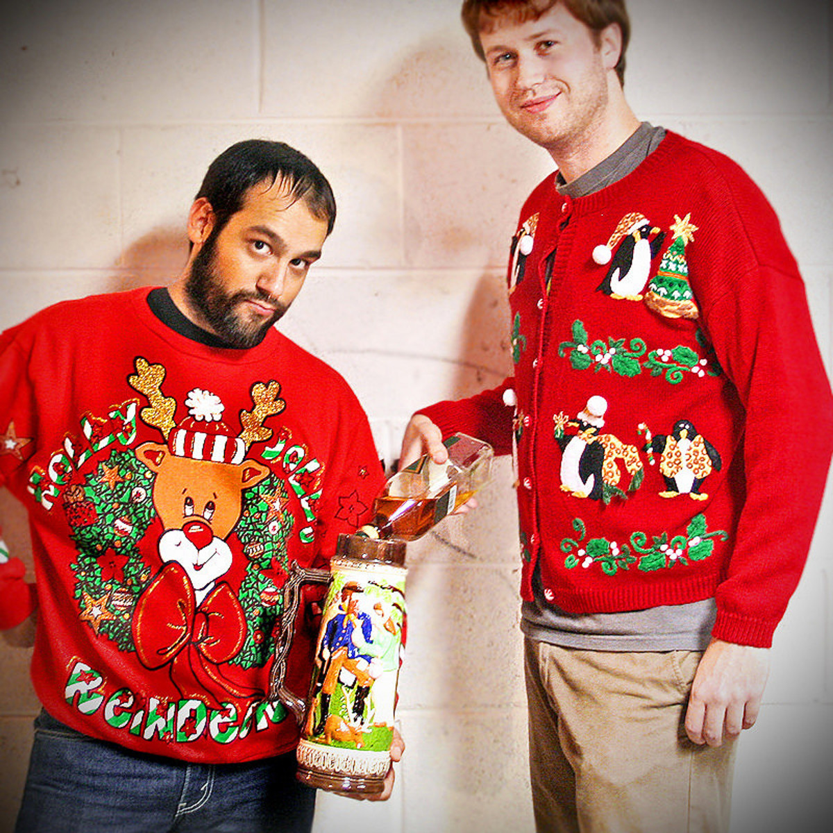 People wearing ugly sweaters.