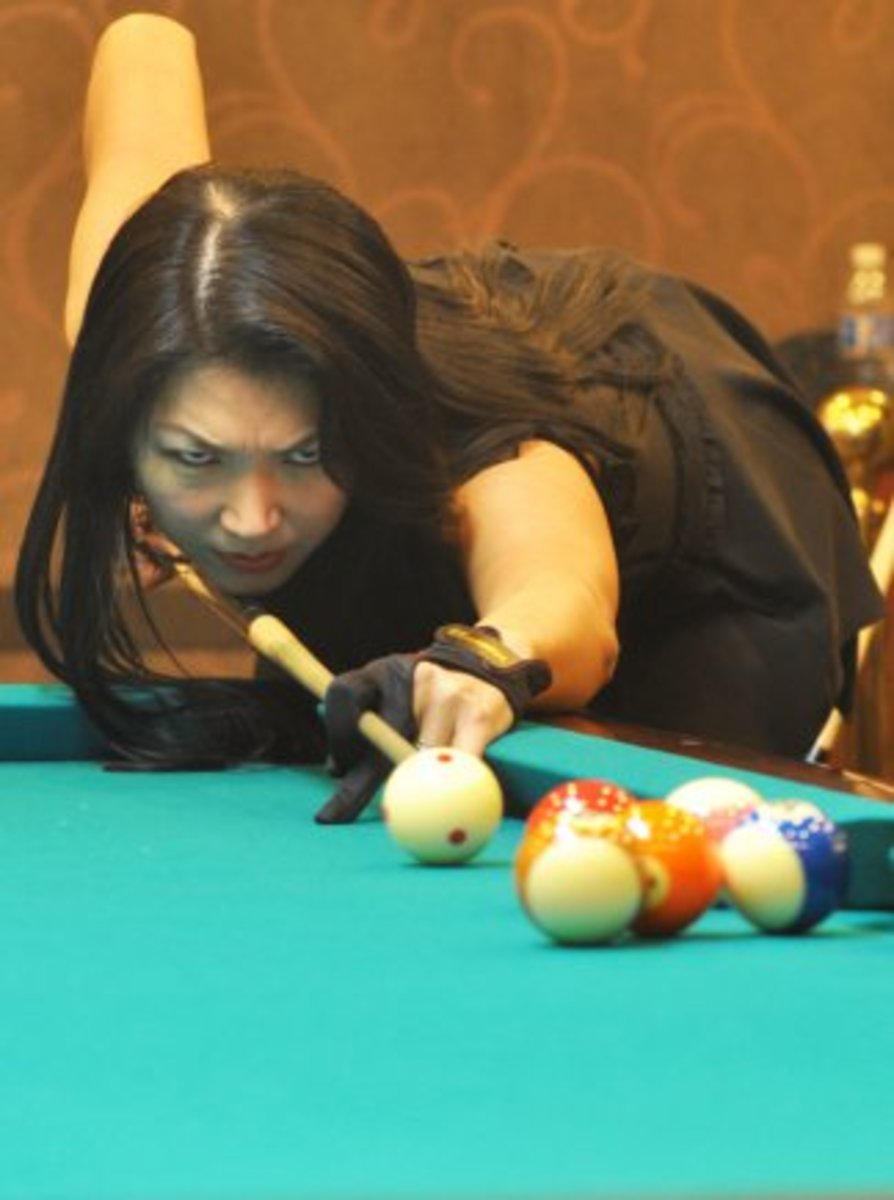 "Jeanette Lee, a.k.a. the ""Black Widow,"" uses a glove, like many professional pool players."