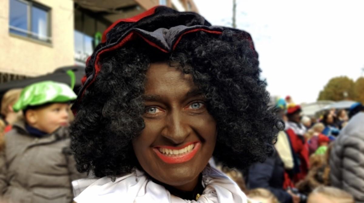 This photo is of a Dutch reveler dressed as Zwarte Piet aka Black Pete.