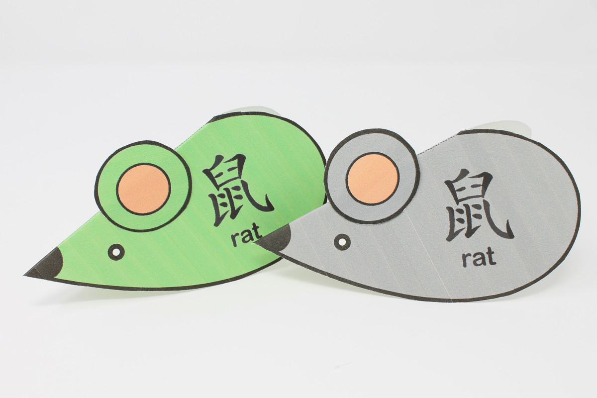 "These rats are made from folded heart shapes and have the word ""rat"" printed in English and Chinese."