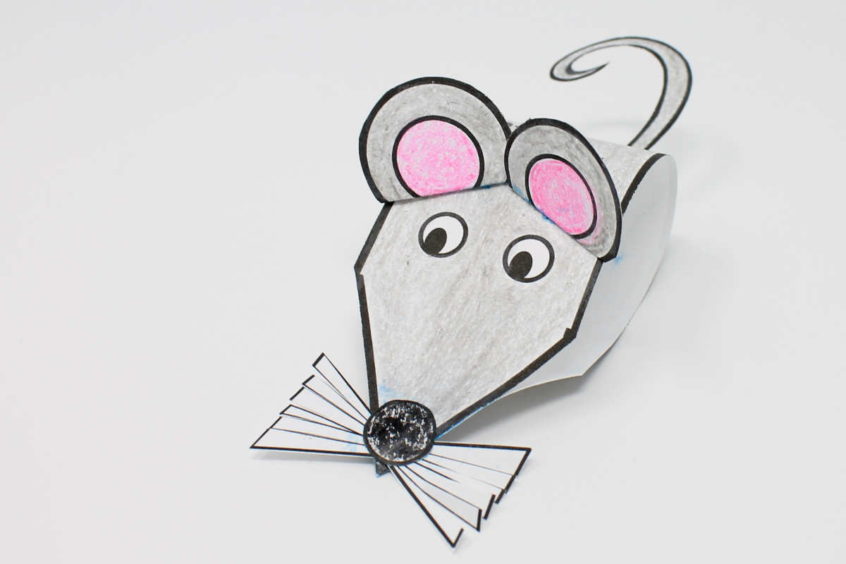 "This little rat is made from a pointed strip, ears, whiskers, and a tail. You can't see it from this angle, but the Chinese character for ""rat"" is printed on its back."