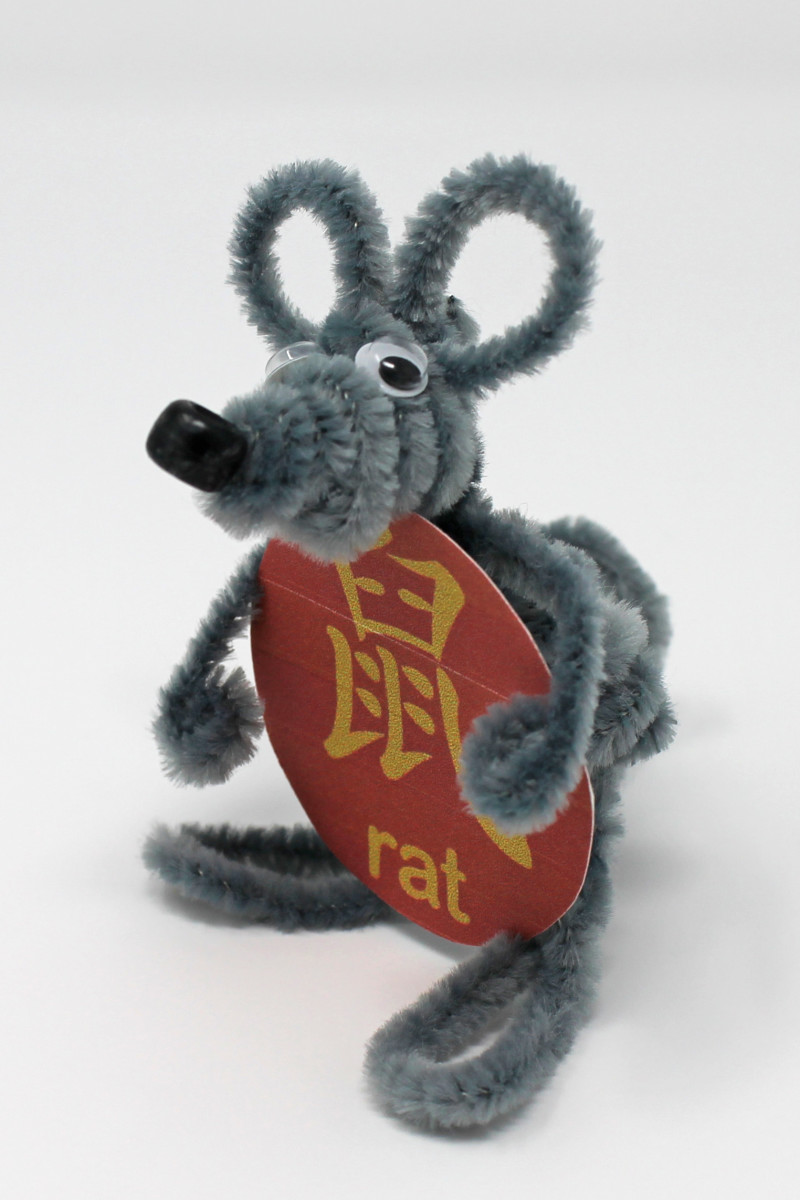"Here is a finished rat made from pipe cleaners. The red circle with the ""rat"" character is available on the ""Printable Templates, Batch 1"" link earlier in this article."